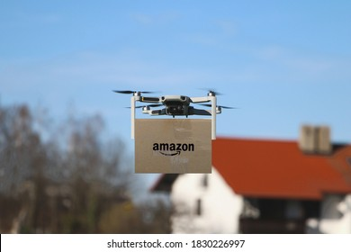 Malaga/Spain - 10-09-2020 : selective focus on drone delivering parcel with amazon logo on cardboard