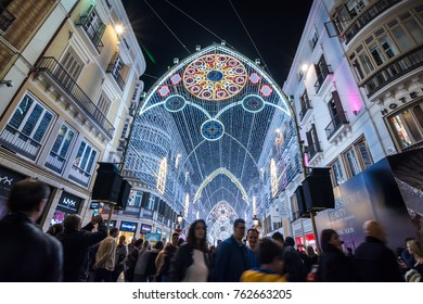 Malaga,Spain. 25 th November 2017. People watching Christmas light show in the centre of Malaga