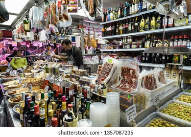 Malaga,Spain on 23rd Mar 2019:Mercado Atarazanas is the main market of Malaga selling legs of ham and rolls of sausages or cheese, fish and endless varieties of olives and all types of fruit and veg