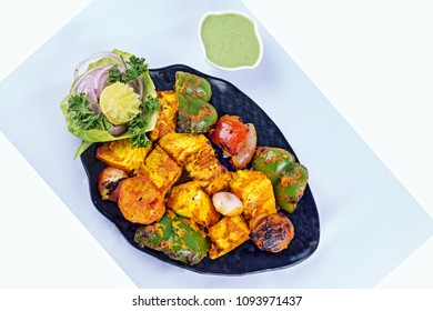 Malai Paneer Tikka Kabab - is an Indian dish made from chunks of cottage cheese marinated in spices, cream & grilled in a tandoor.