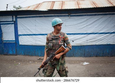 Malakal, South Sudan - March 3, 2014: A United Nations soldier patrols a street