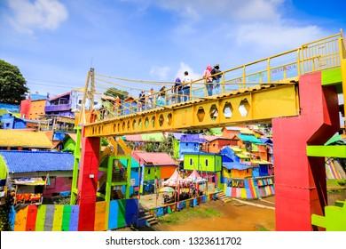 Malang, East Java / Indonesia - Jan 15, 2019: Yellow Glass Ngalam Bridge at Rainbow Village (Kampung Warna) Jodipan Malang, East Java, Indonesia, Asia