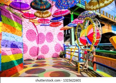 Malang, East Java / Indonesia - Jan 15, 2019: Overhead Umbrellas Decoration at Colorful Rainbow Village (Kampung Warna) Jodipan Malang, East Java, Indonesia, Asia