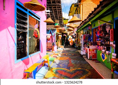 Malang, East Java / Indonesia - Jan 15, 2019: Colorful Unique Wooden Mask Decoration's Alley at Rainbow Village (Kampung Warna) Jodipan Malang, East Java, Indonesia, Asia