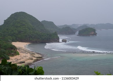 Malang, East Java, Indonesia - January, 2018: View of Goa China Beach during the rainy season.
