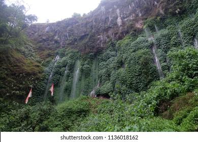 Malang, East Java, Indonesia - Maret, 2018:  View of Sumber Pitu Waterfall located in Pujon, Malang Regency, East Java, Indonesia.