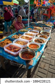 Malang, Indonesia (12-25-2020) - a photo of a woman selling her food in a market