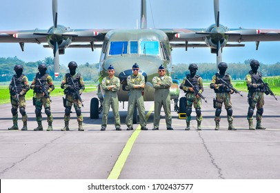 MALANG, INDONESIA - APRIL 21, 2018: Indonesian Air Force Military Soldier are doing simulation in front of the plane in Abdul Rachman Saleh airport Malang, Indonesia.