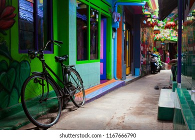 Malang, Indonesia - July 12, 2018: Narrow alley in Jodipan village with colorful houses ( Kampung Warna Warni ). Popular place for city walking tour on family holidays. Travel destination in East Java