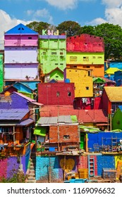 Malang, Indonesia - July 12, 2018: View of old slum village Jodipan with colorful houses in Malang city, East Java.