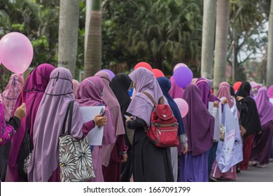 Malang, Indonesia - Marc 1 2020:hijab socialization campaign. followed by young people,in Muslim clothing. walk together in groups.Socializing about hijab and Muslim clothing.at the car free day event