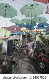 Malang, Indonesia November 2017: Hanging umbrella and sakura in an alley at kampung Jodipan