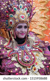 Malang, Indonesia - September 16, 2019: Participant in Malang Flower Festival 2019. Beautiful smile from one of participant. Beautiful Girl. MFC 2019. The carnival is an anual event in this town