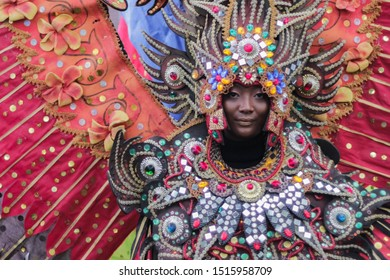 Malang, Indonesia - September 16, 2019: Unidentified woman displaying colorful costume during Malang Flower Carnival. The carnival is an anual event in this town. Beauty Smile