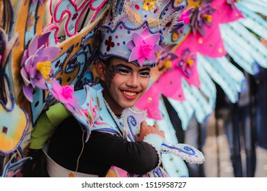 Malang, Indonesia - September 16, 2019: Participant in Malang Flower Festival 2019. Beautiful smile from one of participant. The carnival is an anual event in this town. MFC 2019