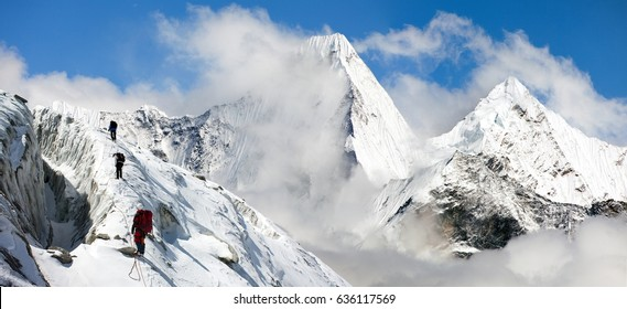 Malangphulang, Beautiful panoramic view of himalayas with clouds near mount Ama Dablam on the way to Everest base camp, Nepal