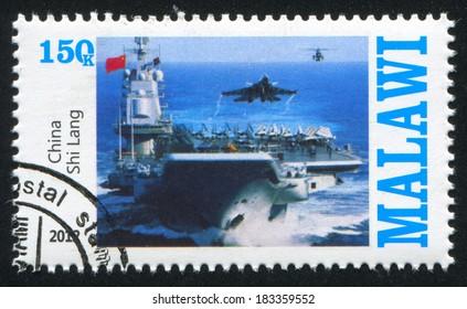 MALAWI - CIRCA 2012: stamp printed by Malawi, shows aircraft carrier, circa 2012