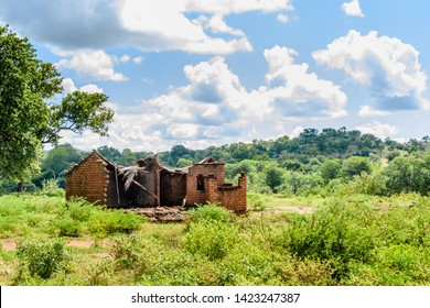 a Malawian village house destroyed by the heavy rain that accompanied a recent cyclone in the area