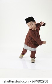 malay boy wearing traditional costume celebrating new year
