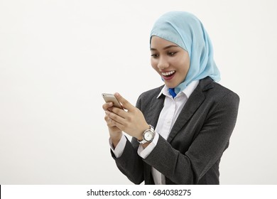 malay business woman  reading using mobile phone
