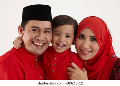 malay couple carring their son