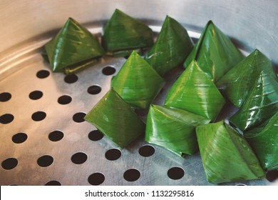 Malay Dumpling which also known as Kuih Koci. It was made from glutinous rice flour, and stuffed with coconut fillings with palm sugar.