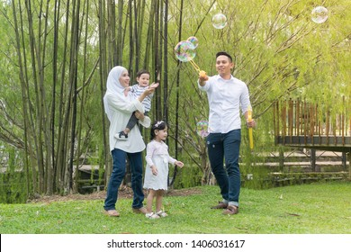 Malay family at recreational park having fun