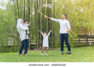 Malay family at recreational park having fun