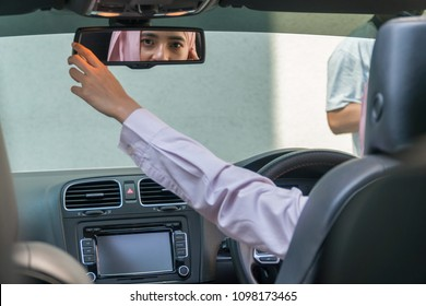 Malay Girl wearing hijab Driving Happy smiling in a car