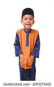 A Malay kids wearing a custom Baju Melayu with isolated white background. This dress is commonly used during festive season such as Aidilfitri celebration