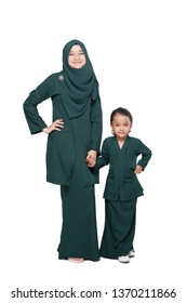 Malay mother and daughter in traditional dress posing