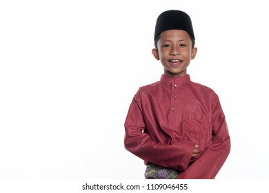 A malay muslim boy wearing a traditional malay costume isolated on white background
