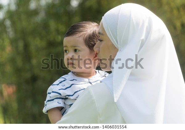Malay muslim mother and son outdoor