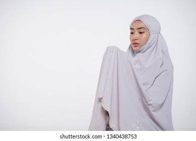 Malay Muslim woman praying. Isolated on white background