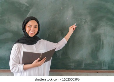 Malay School Teacher at the classroom wearing hijab