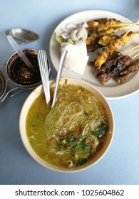 "Malay street food called ""Meehun Soto"" with the soy sauce gravy and delicious.chicken amd beef satay"