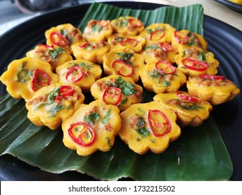 Malay traditional dessert called 'Kuih Cara Berlauk' made in Malaysia with grain and noise effect.