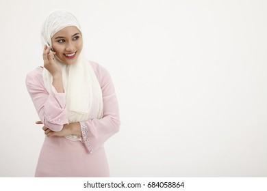 malay with tudung talking on the mobile phone