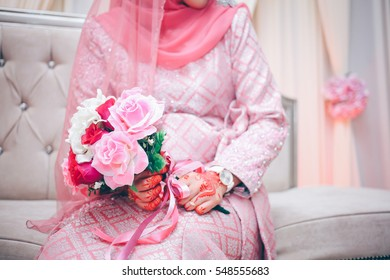 Malay Wedding bride during the marriage ceremony. Selective Focus. Tones Image.