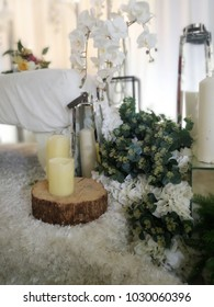 Malay wedding dais with candle on top of wooden decoration
