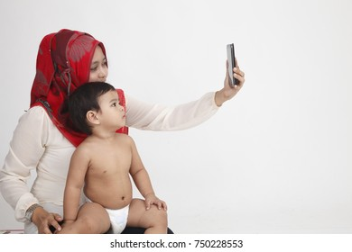 malay woman carrying her son taking picture together