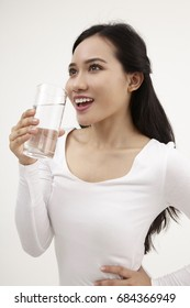 malay woman holding a glass of water