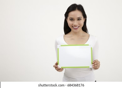 malay woman holding a white board