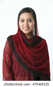 Malay woman with red baju kurung isolated on the white background.