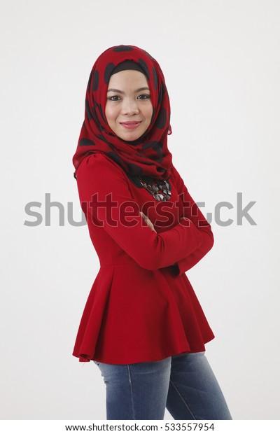 malay woman with red tudung posing