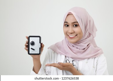 malay woman with tudung holding a coin box