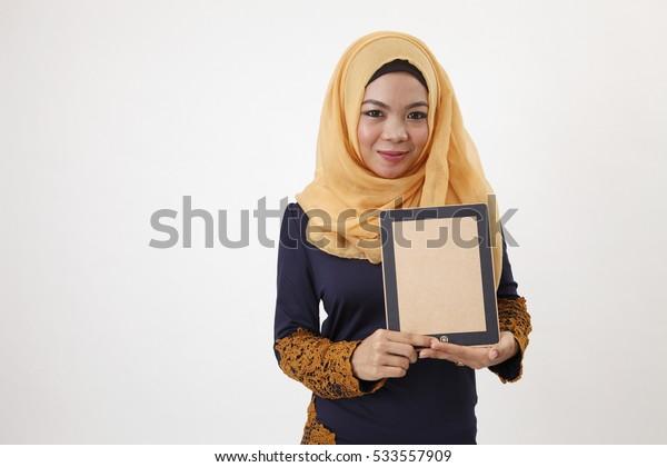 Malay woman with tudung showing dummy ipad