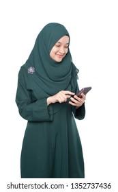 Malay woman using mobile phone