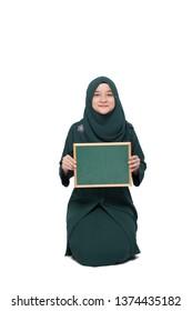 Malay woman wearing hijab with blank black board