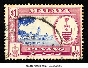 MALAYA - CIRCA 1957: Red color postage stamp printed in Penang (Federation of Malaya) with illustrative image of government offices and the Penang state crest.
